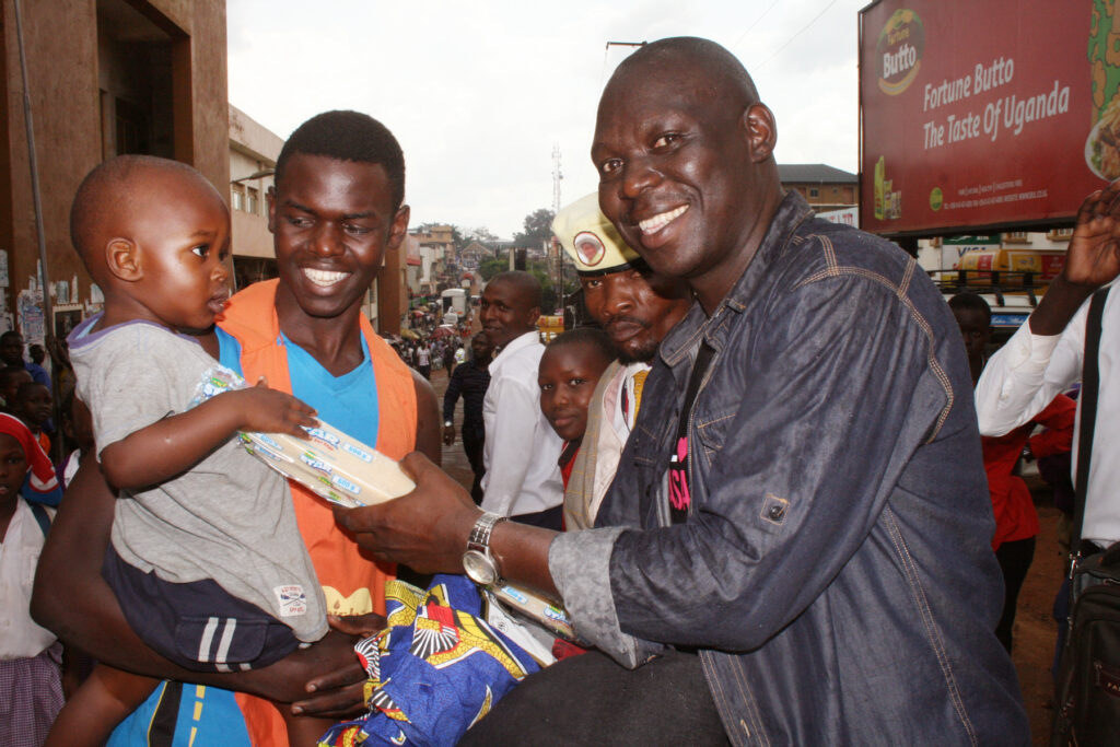 Hon.-Eric-Mukhwana-Minister-of-Information-ICT-Corporate-Affairs-at-Inzu-receives-bar-soap-for-baby-during-the-Disaster-Appeal-Drive