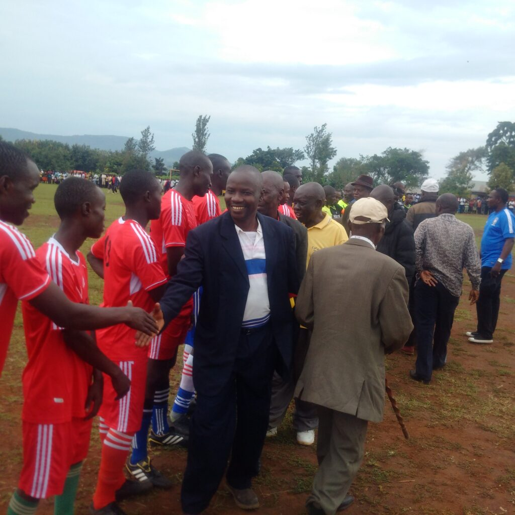 Rt.-Hon.-Michael-Nataka-Deputy-Prime-Minister-for-Resource-Mobilization-Cabinet-Administration-shakes-hands-with-football-team-before-they-started-match-during-Bikuuka-Football-Tournament-2017